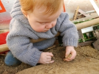 Waylon discovering some rocks and soil